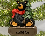 Bear holding tree Ornament by artist Jeff Fleming